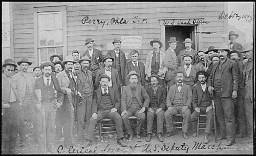 """Fig 5.""""Clerical force & U.S. Deputy Marshalls, U.S. Land Office, Perry, OkIa. Ter. Oct. 12, 1893."""" (National Archives and Records Administration, NAID 516459)."""