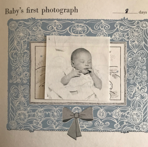 Photo of a baby from a baby book